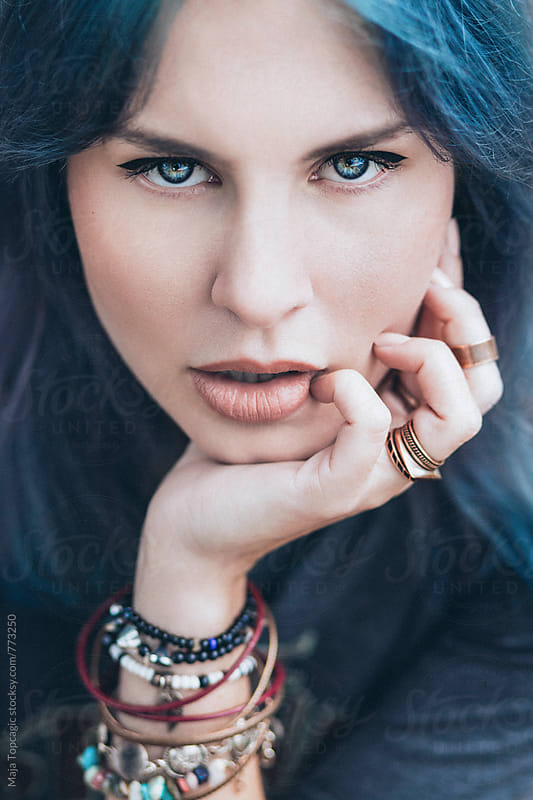 Young beautiful woman with blue hair outside by Maja Topcagic for Stocksy United
