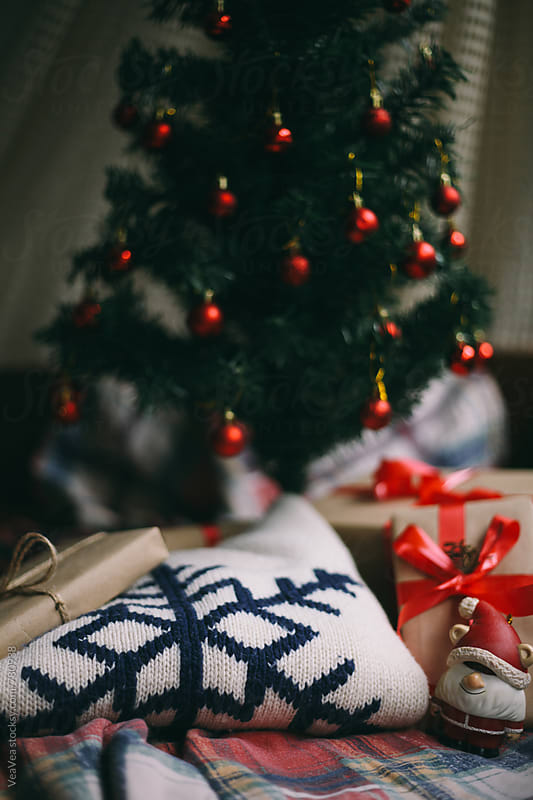 Christmas gifts and sweater below the Christmas tree  by VeaVea for Stocksy United
