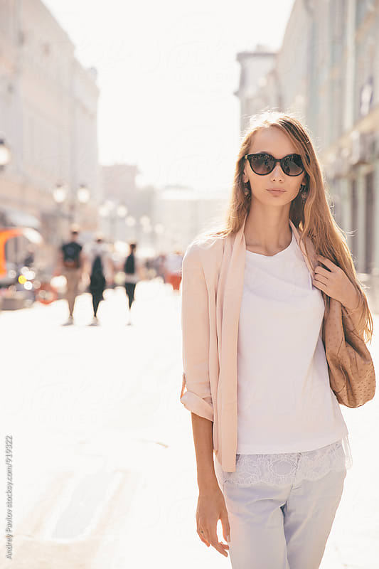 Portrait of young woman in sunglasses by Andrey Pavlov for Stocksy United