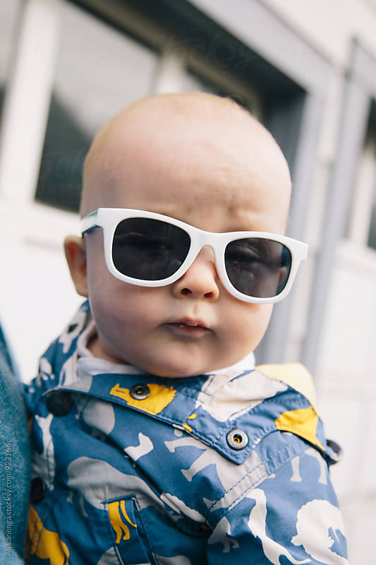 Baby in Sunglasses by Ali Lanenga for Stocksy United