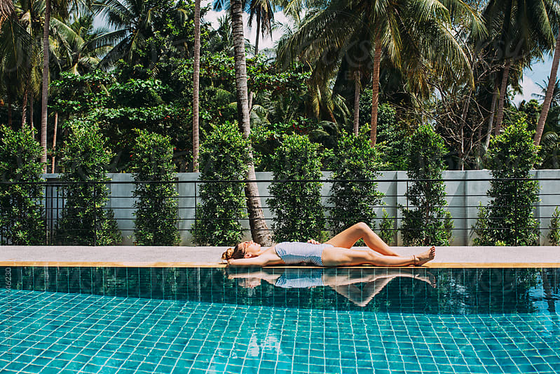 Woman Relaxing by a Swimming Pool by Lumina for Stocksy United