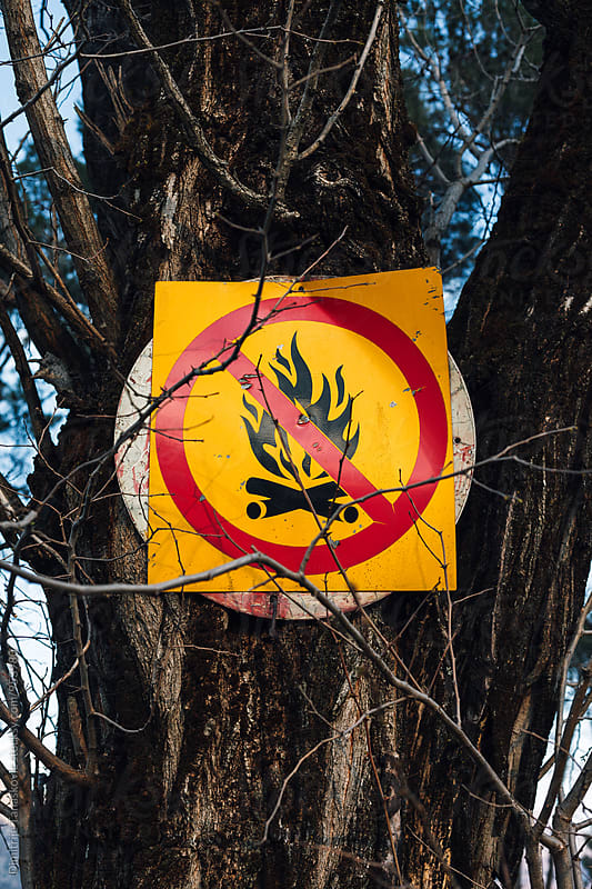 Fire prohibition sign by Dimitrije Tanaskovic for Stocksy United