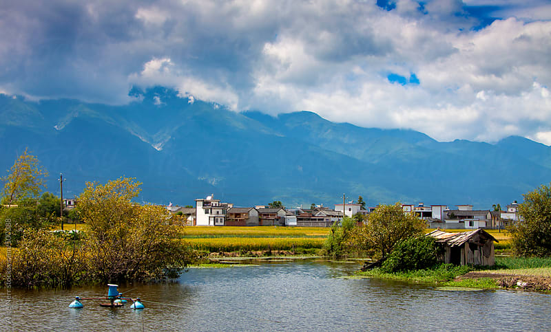 Summer view to the lake and traditional Chinese village by Alice Nerr for Stocksy United