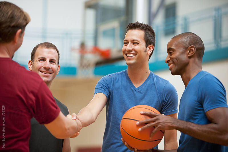 Gym: Guys Meet Up Before Basketball Game by Sean Locke for Stocksy United