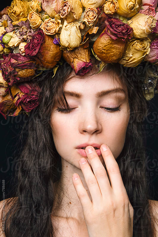 Young woman wearing wreath made of dried flowers. by Danil Nevsky for Stocksy United