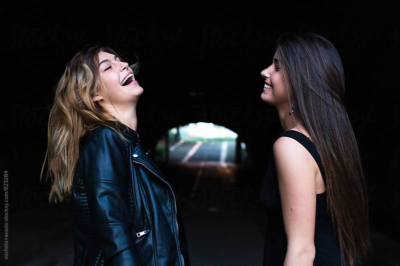 Two female friends having fun together by michela ravasio for Stocksy United