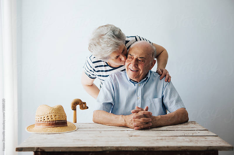 Portrait of a senior couple indoor by Nasos Zovoilis for Stocksy United