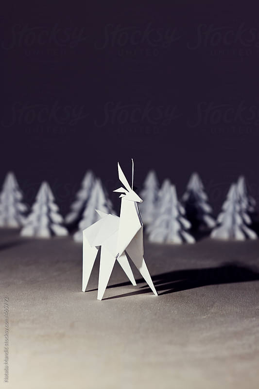 Origami Reindeer by night with origami trees by Nataša Mandić for Stocksy United