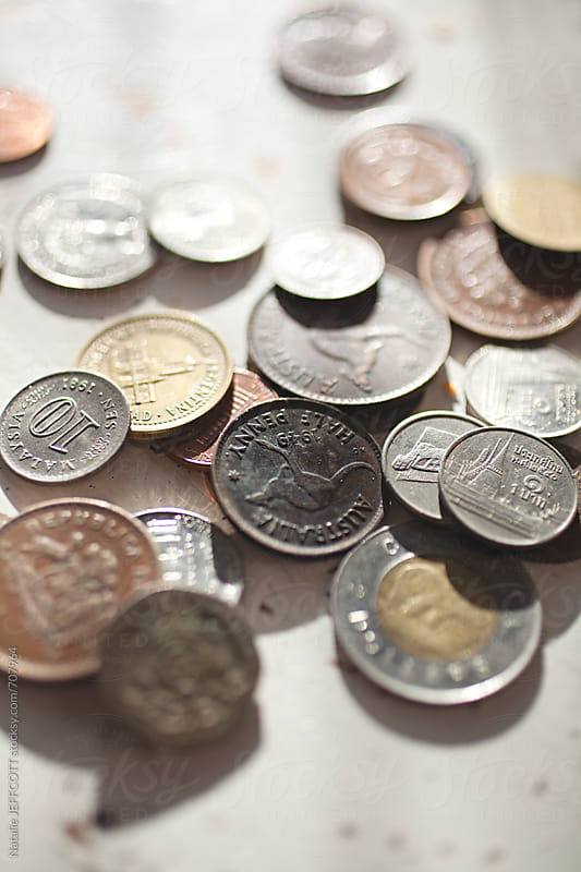 collection of old coins from around the world by Natalie JEFFCOTT for Stocksy United