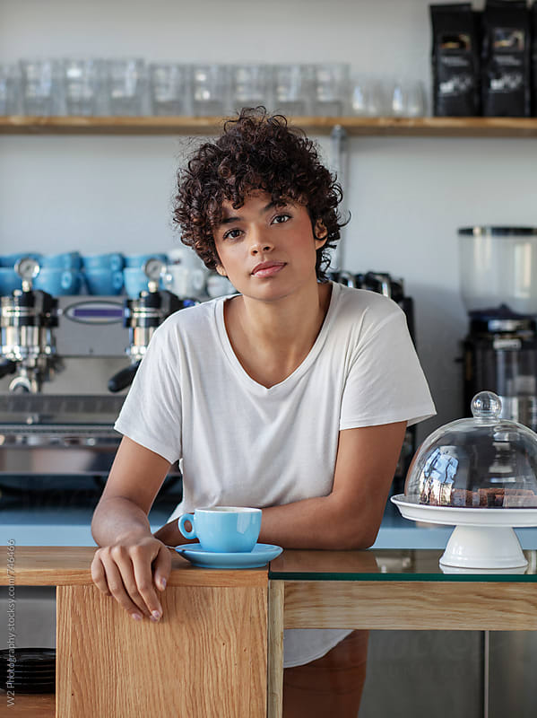 Portrait of beautiful young cofee shop owner by W2 Photography for Stocksy United