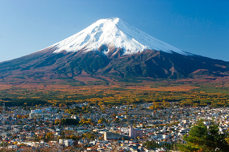 Japan, Central Honshu (Chubu), Fuji-Hakone-Izu National Park, Mount Fuji capped in snow, town of Fujiyoshida in the foreground by Gavin Hellier for Stocksy United