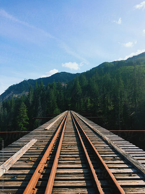 Mobile phone shot of an old wooden railroad bridge by Kristen Curette Hines for Stocksy United