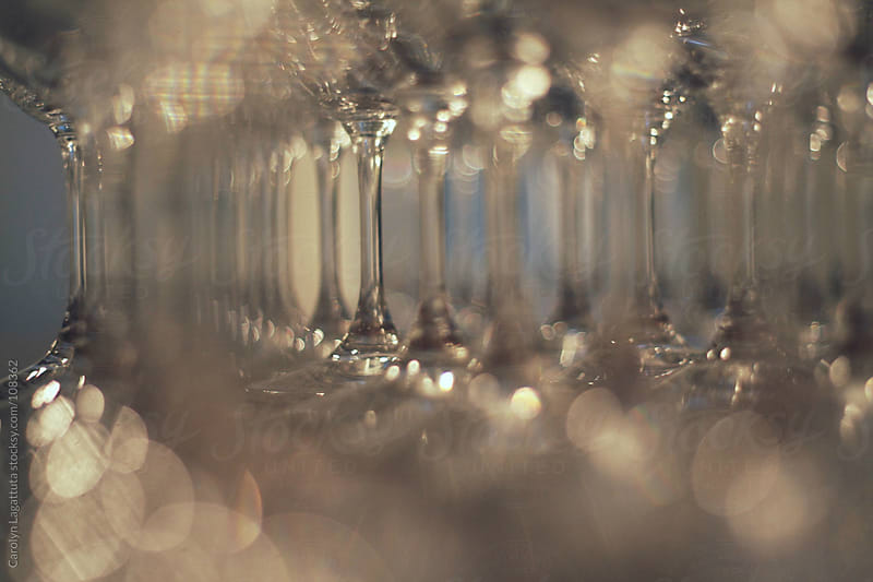 Abstract shot of wine glasses and their stems by Carolyn Lagattuta for Stocksy United