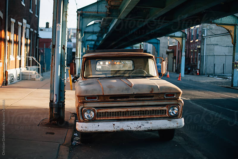 Rusty Truck in Urban Area by Christian Gideon for Stocksy United