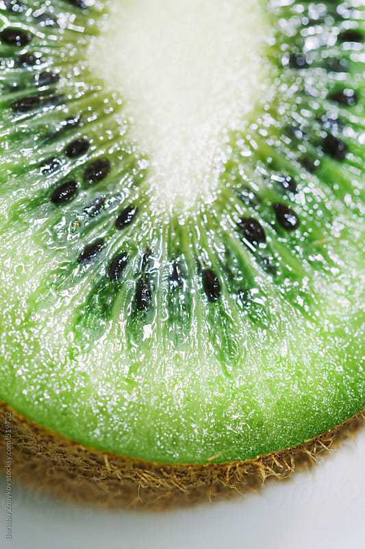 Sliced Kiwi Close Up by Borislav Zhuykov for Stocksy United
