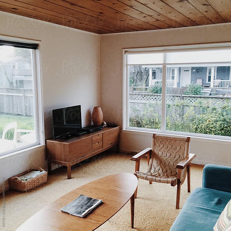 Mid century modern living room by KATIE + JOE for Stocksy United