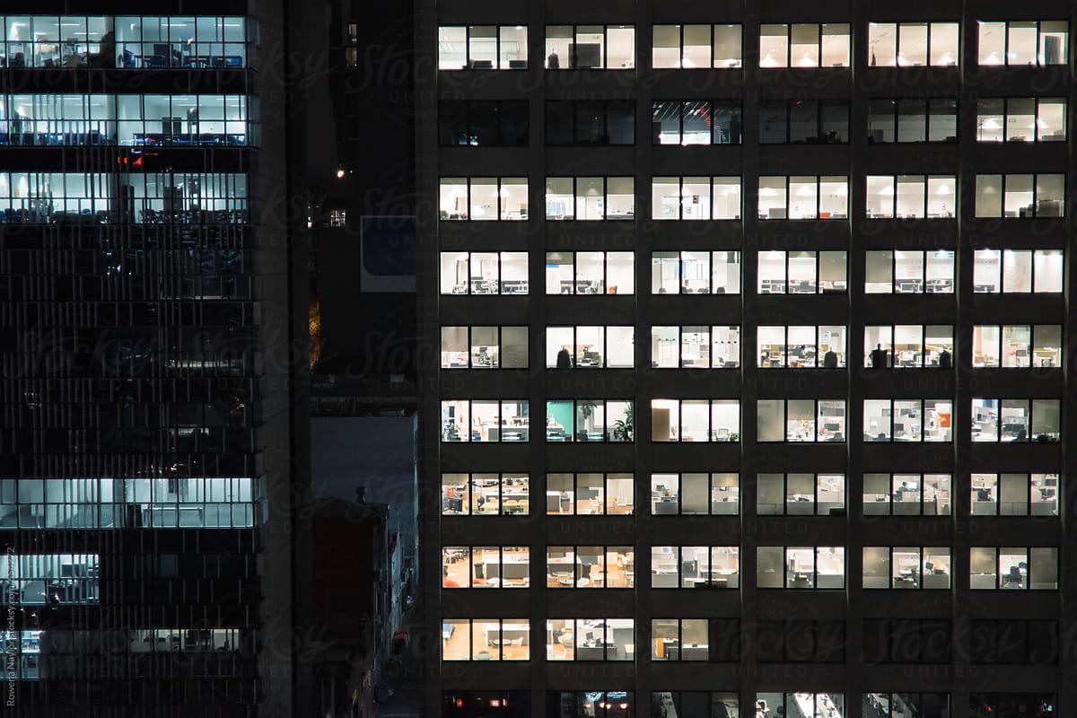 City office buildings illuminated at night by Rowena Naylor - Stocksy United