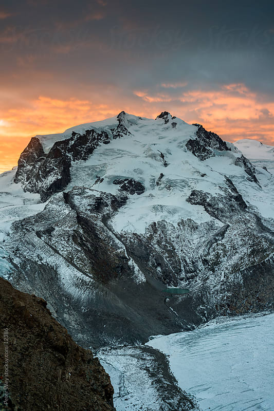 Mountains of Switzerland, Zermatt, Gornergrat: Monte Rosa at sunrise by Peter Wey for Stocksy United