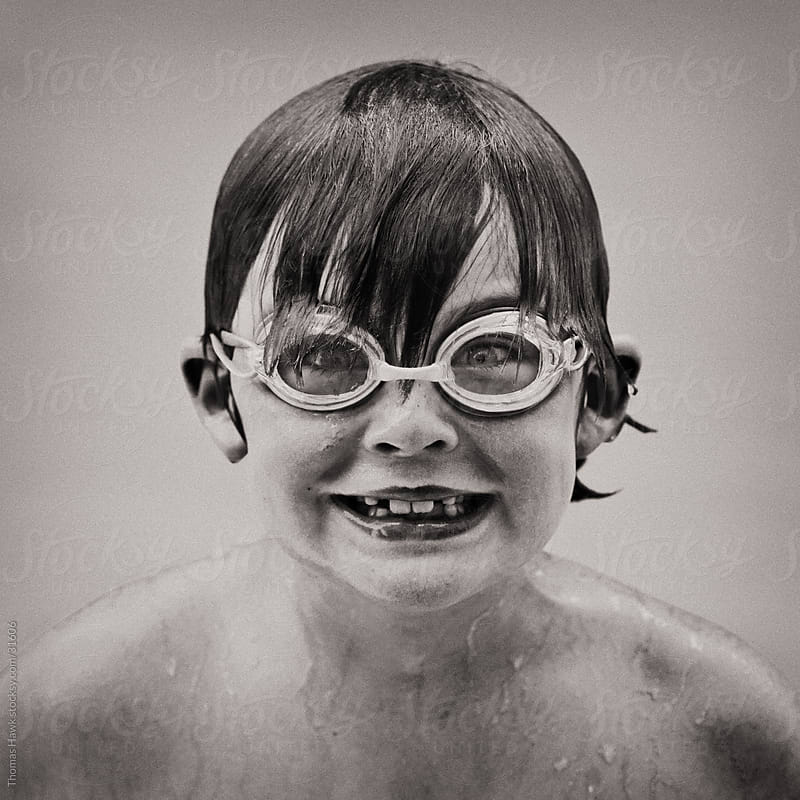 Boy Grinning While Swimming by Thomas Hawk for Stocksy United
