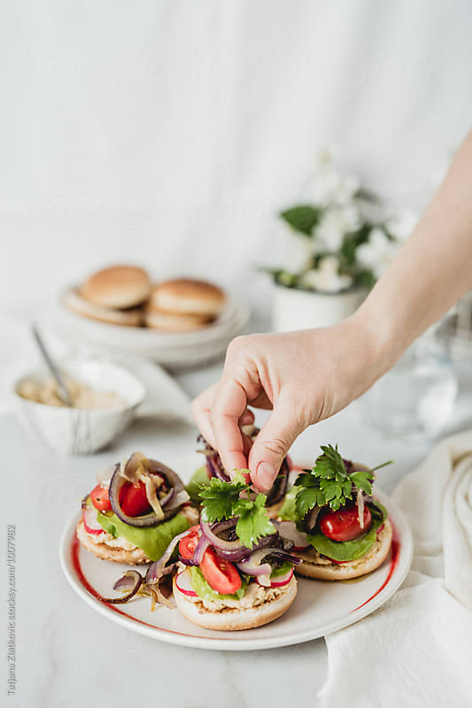 Making vegan sandwiches by Tatjana Zlatkovic for Stocksy United
