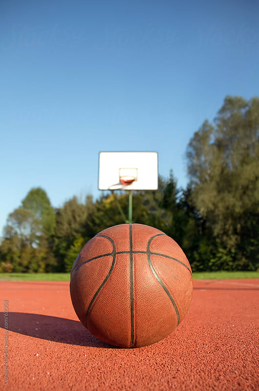 basketball on a basketball court by Leander Nardin for Stocksy United