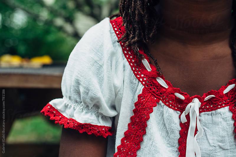 Detail of a shirt on a black girl by Gabriel (Gabi) Bucataru for Stocksy United
