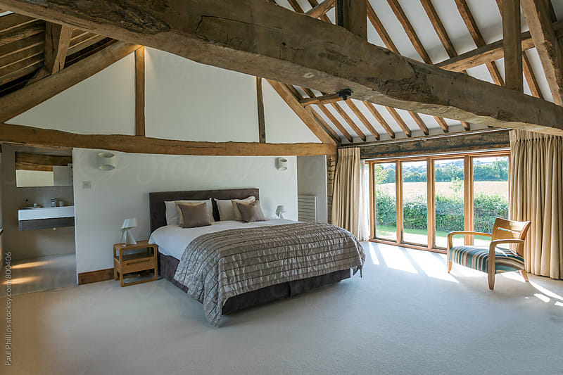 Bedroom in a converted timber framed building by Paul Phillips for Stocksy United