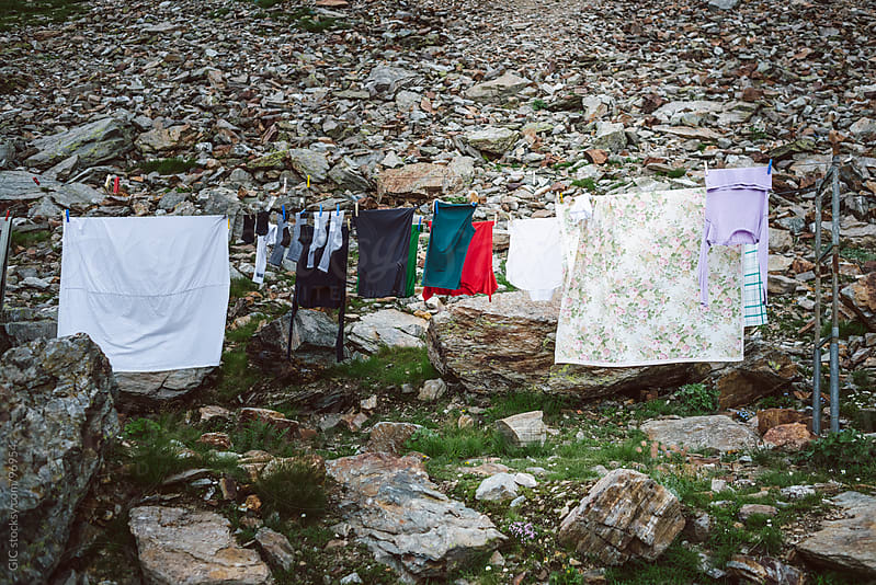 Hanging clothes outdoors by GIC for Stocksy United