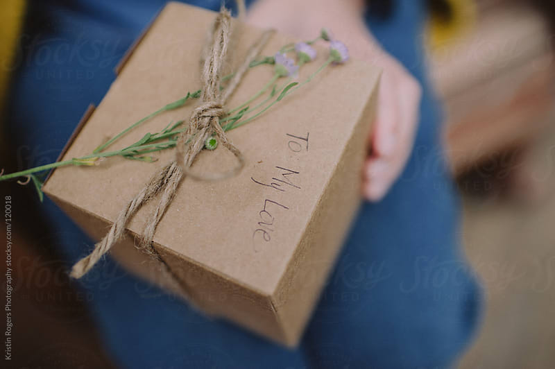 natural box with wild flower as a gift by Kristin Rogers Photography for Stocksy United