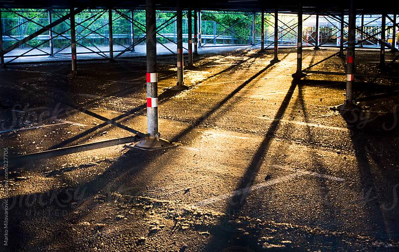 Empty car parking in sunset by Marko Milovanović for Stocksy United