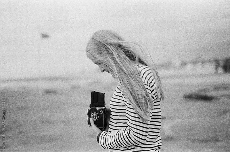 A portrait of woman taking picture with old analog camera by Anna Malgina for Stocksy United