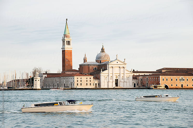 View of San Giorgio Maggiore with two boats  by Bisual Studio for Stocksy United