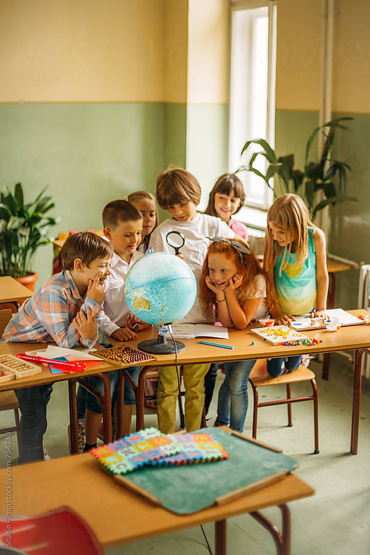 School Time. Pupils Having Fun at School by Studio Firma for Stocksy United