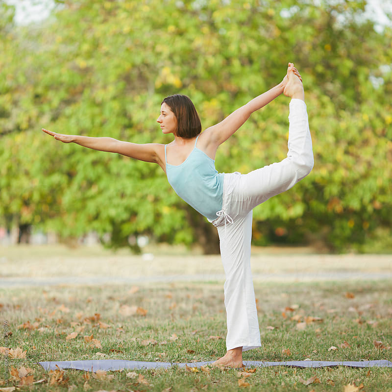Caucasian Woman Doing Yoga Outdoors by Lumina for Stocksy United