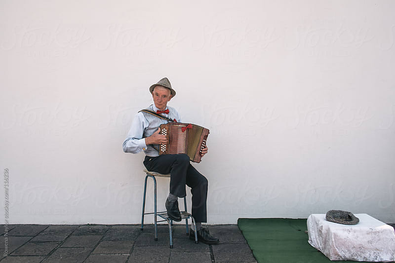 Old Irish Busker Playing the Accordion by Rowena Naylor for Stocksy United
