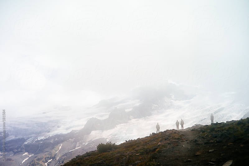 Silhouettes looking at glacier by Caitlin Strom for Stocksy United
