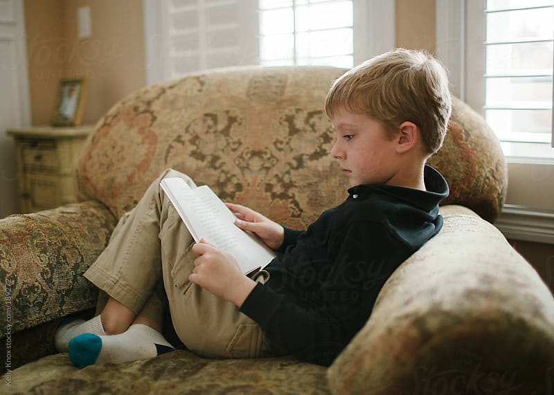 boy reading a book by Kelly Knox for Stocksy United