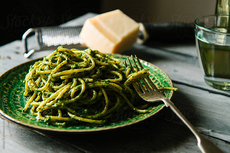 Spaghetti with watercress pesto. by Helen Rushbrook for Stocksy United