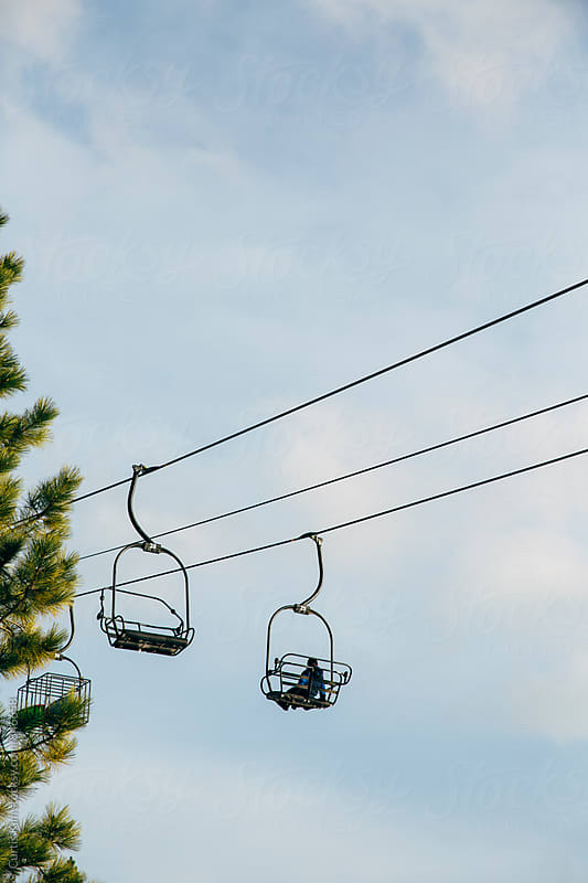 Ski resort chair lift by Curtis Kim for Stocksy United