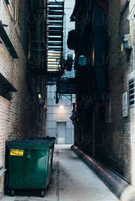 a city alley by Margaret Vincent for Stocksy United