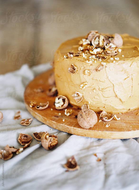 Sweet Cake with walnuts by Julia Kaptelova for Stocksy United
