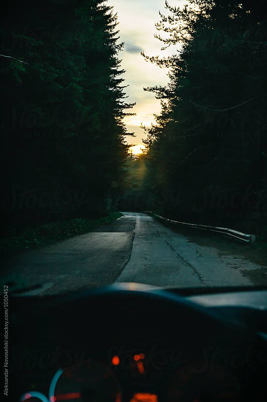 Driving in the mountain by sunset by Aleksandar Novoselski for Stocksy United