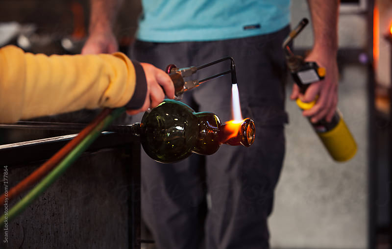 Glass: Female Artist Uses Torch To Heat Part of Art Piece by Sean Locke for Stocksy United
