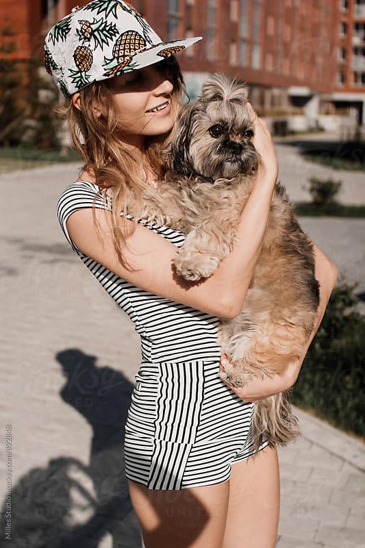 Girl holding dog outside by Milles Studio for Stocksy United