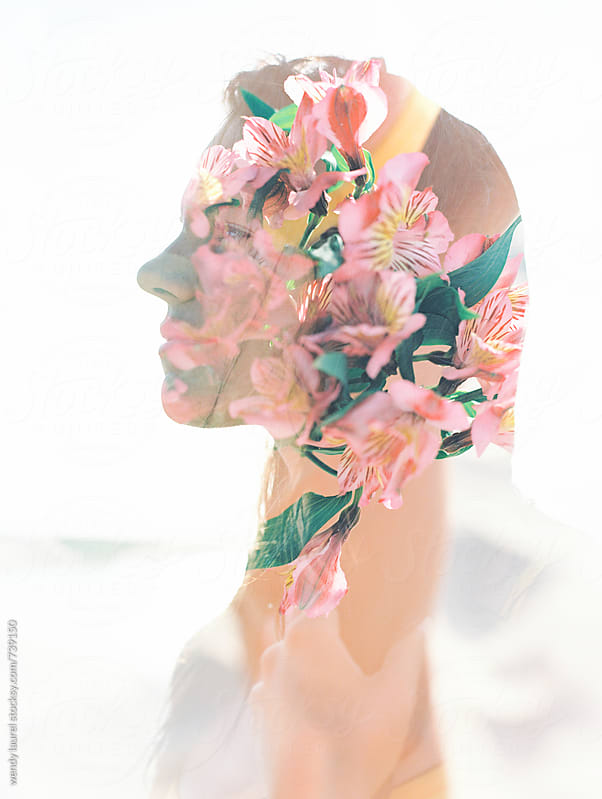 double exposure on film of womans profile and flowers by wendy laurel for Stocksy United