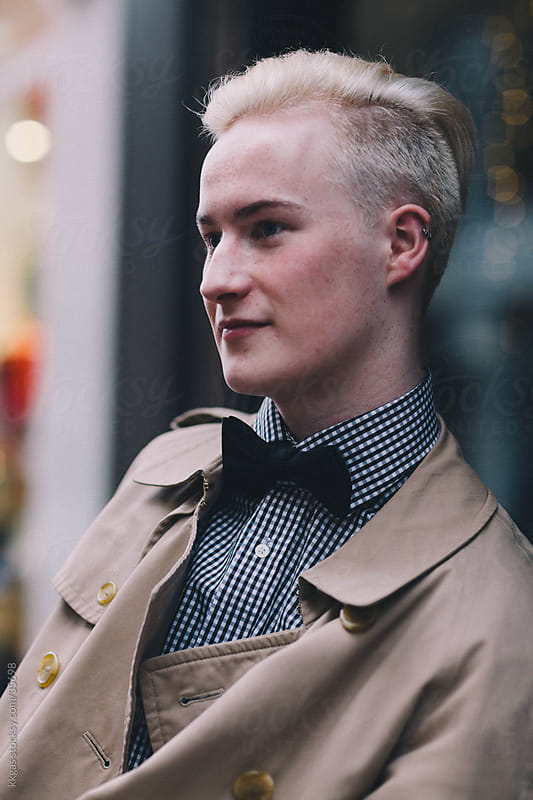Fashionable blonde man in a street in Soho London,  by kkgas for Stocksy United