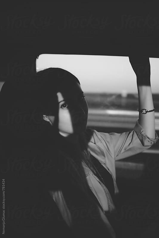 Abstract Black and White Portrait of a Female Commuter by Nemanja Glumac for Stocksy United