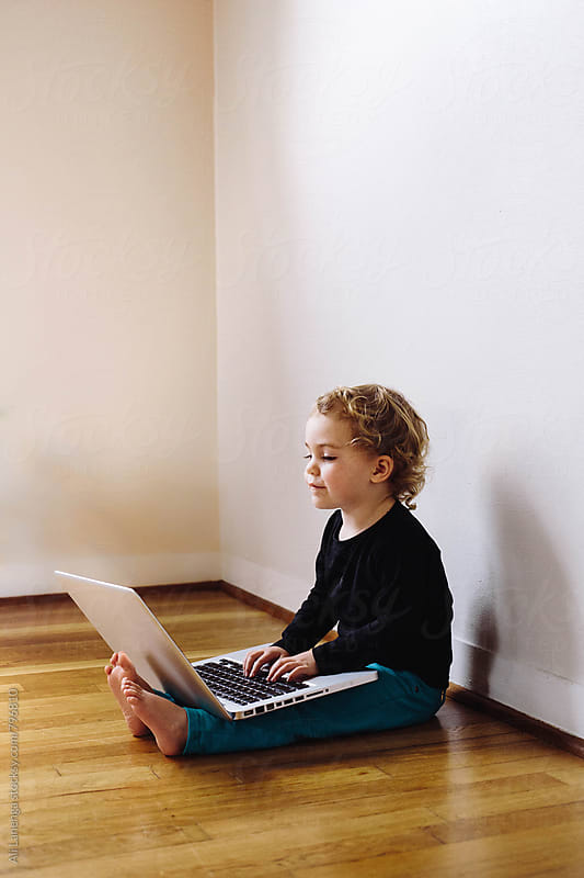 Girl on a computer by Ali Lanenga for Stocksy United