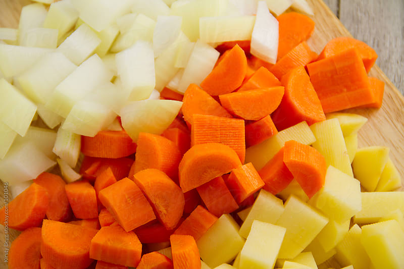Diced vegetables, onion, carrot and potato by Kirsty Begg for Stocksy United