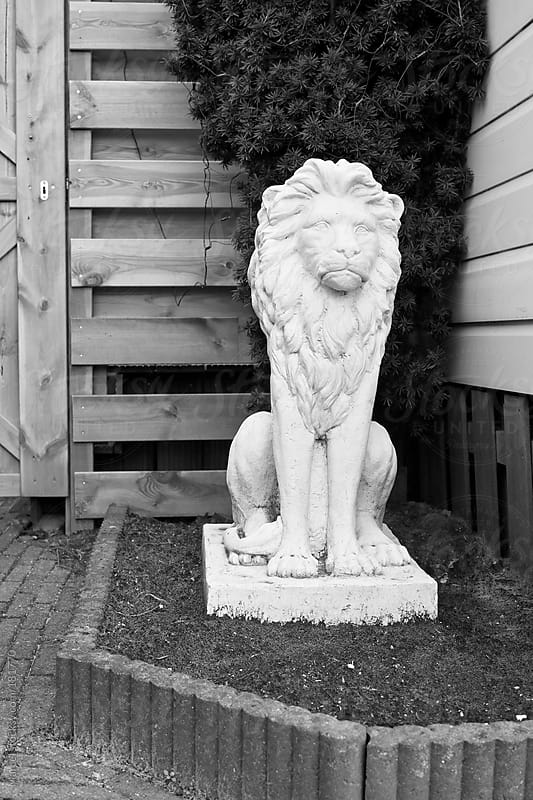 Sad concrete lion statue by Marcel for Stocksy United